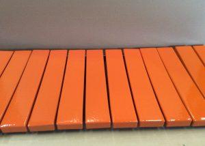 Foam coated with orange polyurea